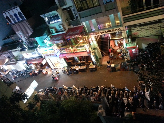 You might see a vibrant street in Saigon. We see a challenge - eating dinner in a foreign country.