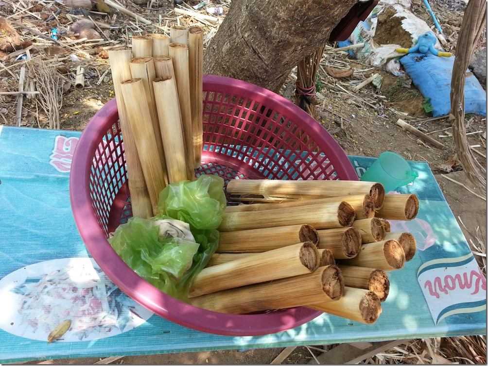 Bamboo sticky rice for sale at a roadside stand.