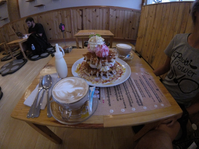 Coffee and waffle stack at Cat N A Cup... super delicious.